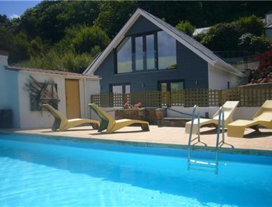 This is a stunning view across the pool to the 3 bedroom cottage.