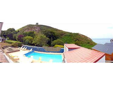 This panoramic image shows the view from the master bedroom and the start of the sea view