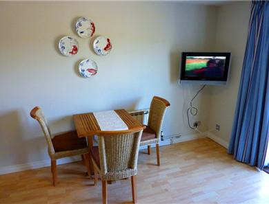 2 bedroom standard dining area.  Extra chairs are available!