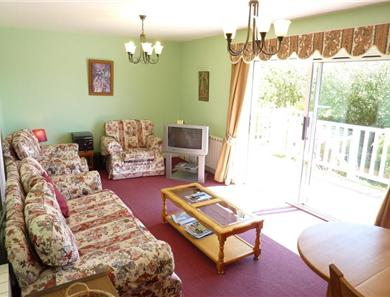 The lounge area is bright and leads directly onto the balcony with access down to the garden.