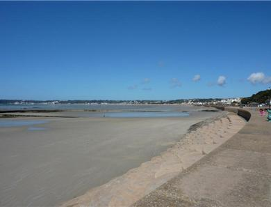 This shows the expanse of beach at low tide which stretches all the way to St Aubin's village