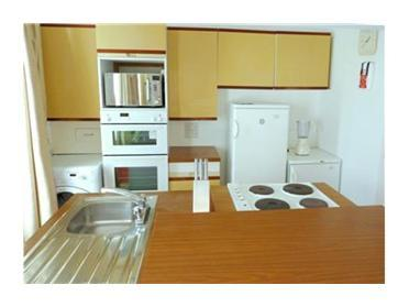 The kitchen area in the first floor 1 bedroom apartment