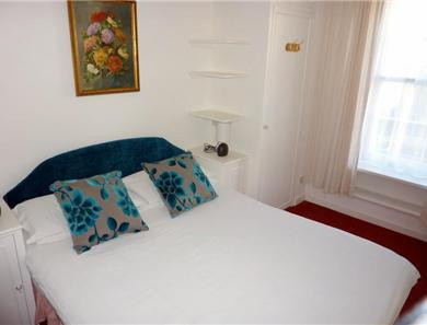 Bedroom in the first floor apartment which also has integral bathroom and separate wc