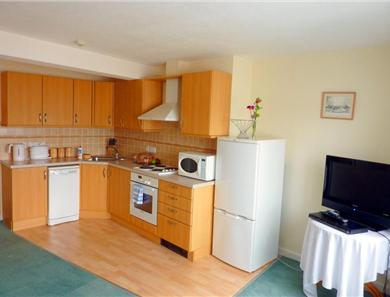An example of a 2 bedroom sea view kitchen-lounge-diner, styles vary from apartment to apartment