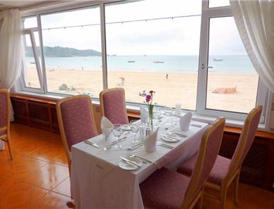 The restaurant at its best with one of the sea view tables
