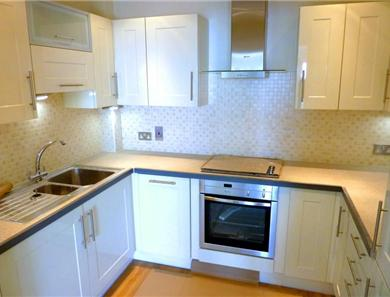 The kitchen is fully equipped including microwave and full cooking facilities.