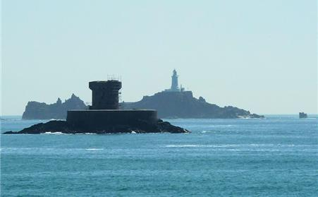 Le Braye fort with Corbiere lighthouse showning in the distance